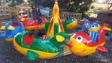 מתקן לונה פארק קרוסלת מטוסים צבעוניים